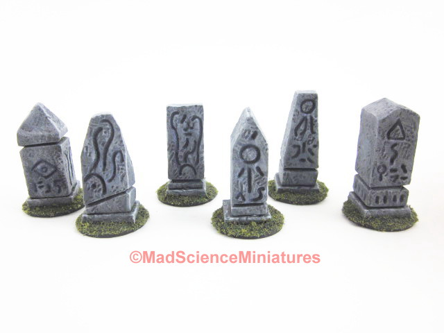 Small stone markers inscribed with arcane symbols inspired by H. P. Lovecraft.